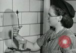 Image of women workers United States USA, 1942, second 16 stock footage video 65675032088