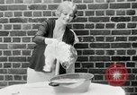 Image of blond girl New York United States USA, 1930, second 18 stock footage video 65675032161