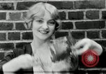 Image of blond girl New York United States USA, 1930, second 27 stock footage video 65675032161
