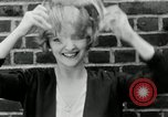 Image of blond girl New York United States USA, 1930, second 29 stock footage video 65675032161