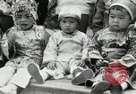 Image of oriental baby show Portland Oregon USA, 1930, second 14 stock footage video 65675032164
