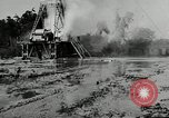 Image of oil drilling derrick United States USA, 1940, second 7 stock footage video 65675032168