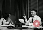 Image of sexual harassment in the workplace United States USA, 1950, second 21 stock footage video 65675032176