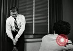 Image of sexual harassment in the workplace United States USA, 1950, second 35 stock footage video 65675032176