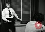 Image of sexual harassment in the workplace United States USA, 1950, second 36 stock footage video 65675032176
