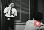 Image of sexual harassment in the workplace United States USA, 1950, second 37 stock footage video 65675032176