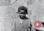 Image of people in rural area United States USA, 1935, second 56 stock footage video 65675032228
