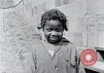Image of people in rural area United States USA, 1935, second 57 stock footage video 65675032228