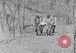 Image of people in rural area United States USA, 1935, second 59 stock footage video 65675032232