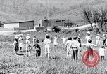 Image of people in rural area United States USA, 1935, second 28 stock footage video 65675032234