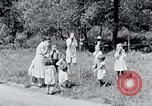 Image of people in rural area United States USA, 1935, second 44 stock footage video 65675032234