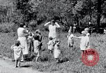 Image of people in rural area United States USA, 1935, second 58 stock footage video 65675032234