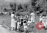 Image of people in rural area United States USA, 1935, second 62 stock footage video 65675032234