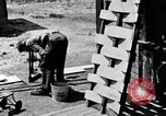 Image of people in rural area United States USA, 1935, second 22 stock footage video 65675032237