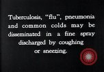 Image of disease causing bacteria sneezing or coughing United States USA, 1922, second 2 stock footage video 65675032296