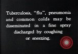 Image of disease causing bacteria sneezing or coughing United States USA, 1922, second 3 stock footage video 65675032296