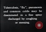 Image of disease causing bacteria sneezing or coughing United States USA, 1922, second 4 stock footage video 65675032296