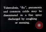 Image of disease causing bacteria sneezing or coughing United States USA, 1922, second 5 stock footage video 65675032296