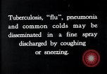 Image of disease causing bacteria sneezing or coughing United States USA, 1922, second 6 stock footage video 65675032296