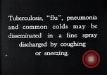 Image of disease causing bacteria sneezing or coughing United States USA, 1922, second 7 stock footage video 65675032296
