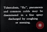 Image of disease causing bacteria sneezing or coughing United States USA, 1922, second 8 stock footage video 65675032296