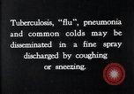 Image of disease causing bacteria sneezing or coughing United States USA, 1922, second 9 stock footage video 65675032296