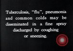 Image of disease causing bacteria sneezing or coughing United States USA, 1922, second 10 stock footage video 65675032296