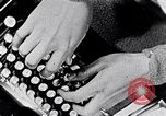 Image of hands performing various jobs late 1930s United States USA, 1937, second 2 stock footage video 65675032298