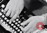 Image of hands performing various jobs late 1930s United States USA, 1937, second 3 stock footage video 65675032298