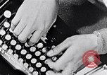 Image of hands performing various jobs late 1930s United States USA, 1937, second 4 stock footage video 65675032298