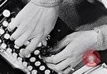 Image of hands performing various jobs late 1930s United States USA, 1937, second 5 stock footage video 65675032298