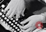 Image of hands performing various jobs late 1930s United States USA, 1937, second 7 stock footage video 65675032298
