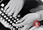 Image of hands performing various jobs late 1930s United States USA, 1937, second 10 stock footage video 65675032298