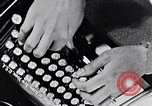 Image of hands performing various jobs late 1930s United States USA, 1937, second 15 stock footage video 65675032298