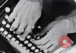 Image of hands performing various jobs late 1930s United States USA, 1937, second 16 stock footage video 65675032298