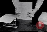 Image of hands performing various jobs late 1930s United States USA, 1937, second 19 stock footage video 65675032298