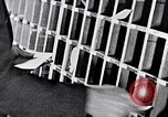 Image of hands performing various jobs late 1930s United States USA, 1937, second 32 stock footage video 65675032298