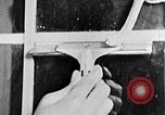 Image of hands performing various jobs late 1930s United States USA, 1937, second 51 stock footage video 65675032298