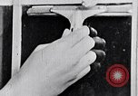 Image of hands performing various jobs late 1930s United States USA, 1937, second 54 stock footage video 65675032298