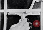Image of hands performing various jobs late 1930s United States USA, 1937, second 58 stock footage video 65675032298