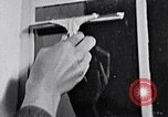 Image of hands performing various jobs late 1930s United States USA, 1937, second 61 stock footage video 65675032298