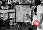 Image of Palmer Hayden painting New York City USA, 1937, second 1 stock footage video 65675032301