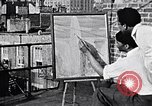 Image of Palmer Hayden painting New York City USA, 1937, second 2 stock footage video 65675032301