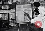Image of Palmer Hayden painting New York City USA, 1937, second 3 stock footage video 65675032301
