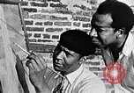 Image of Palmer Hayden painting New York City USA, 1937, second 15 stock footage video 65675032301