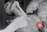 Image of Richmond Barthe designing sculpture New York City USA, 1937, second 32 stock footage video 65675032304