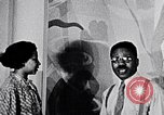 Image of Aaron Douglas and large painting New York City USA, 1937, second 22 stock footage video 65675032306