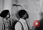 Image of Aaron Douglas and large painting New York City USA, 1937, second 27 stock footage video 65675032306