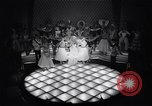 Image of dancers in night club Paris France, 1956, second 6 stock footage video 65675032323