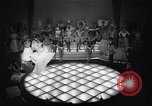 Image of dancers in night club Paris France, 1956, second 17 stock footage video 65675032323